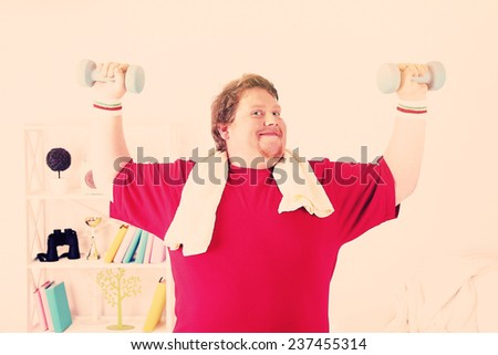 Large fitness man working out at home - stock photo