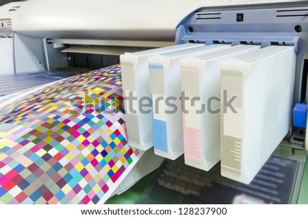 large format ink jet printer cartridge with color management target paper roll - stock photo