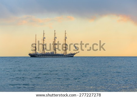Large four masts windjammer Kruzenshtern at sea sunset time - stock photo