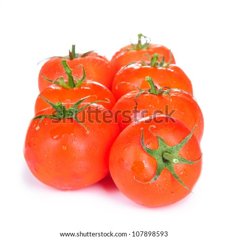 large fresh red tomatoes. close-up. isolated on a white background