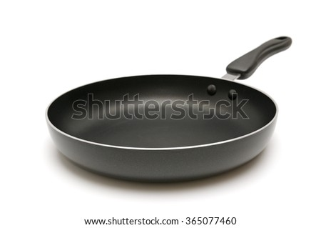 Large frying pan isolated on white - stock photo