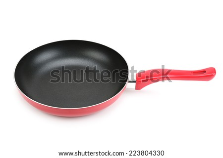 Large frying pan isolated on white background - stock photo
