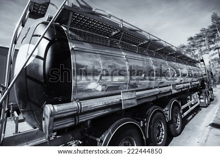 large fuel and oil truck, tanker, in for re-fueling. - stock photo