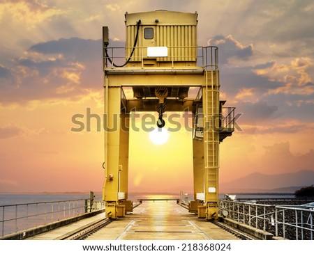 Large Gantry Crane on Sunset at Ubonrat Dam, khonkaen, Thailand - stock photo