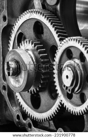 Large gears in the engine.black and white - stock photo