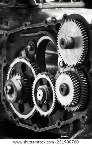 Large gears in the engine.vertical - stock photo