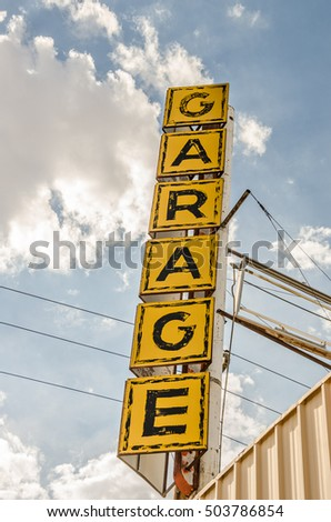 Large generic sign for a garage in big, bold letters and colors