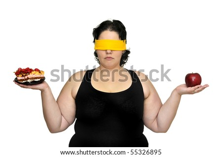 Large girl blindfolded holding a cake and an apple isolated in white - stock photo