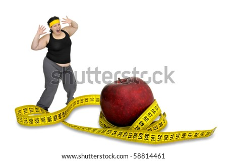 Large girl with apple and measuring tape - stock photo