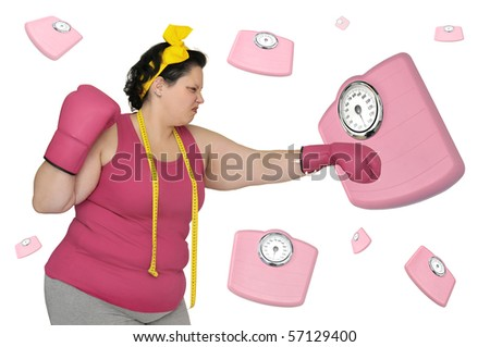 Large girl with boxing gloves beating  a scale isolated in white - stock photo