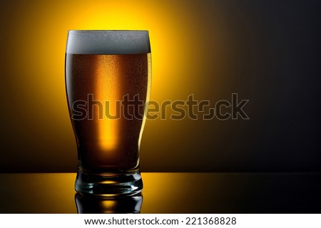 Large glass with a black beer