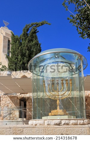 Large gold-plated menorah. Exhibited in Jerusalem in a huge glass cover - stock photo