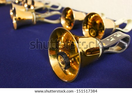 Large golden hand bells - stock photo