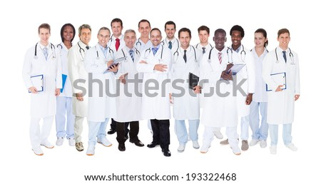 Large group confident doctors standing against white background - stock photo