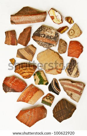 Large group of ancient colorful ceramic shards from different epochs of Israel history. Isolated on white. Good for background. - stock photo