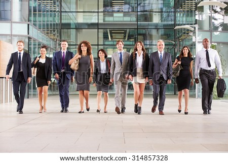 Large group of business people in lobby of a big business - stock photo