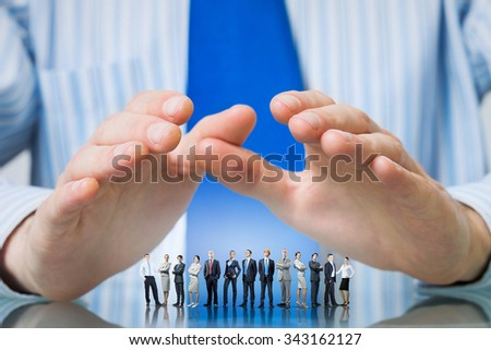 Large group of business people protected with hands