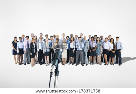 Large Group of Business People with Microphone