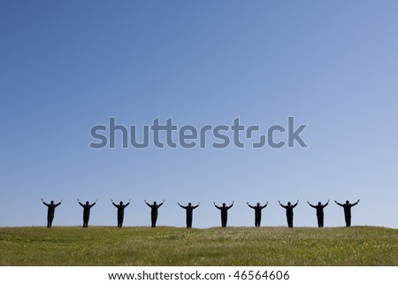 large group of businessman in the field with his arms outstretched - stock photo