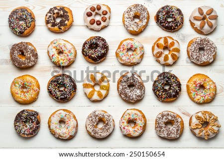 Large group of colorfully decorated donuts - stock photo