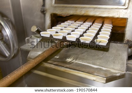 large group of cupcakes ready for baking - stock photo