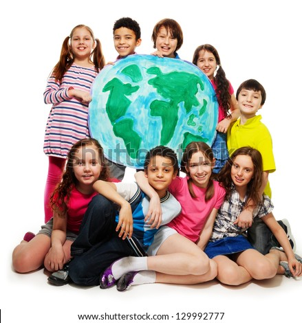 Large group of diversity looking teen kids, boys and girls holding globe map