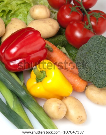 Large group of fresh vegetables on white background