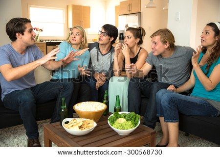 Large group of friends at a party get together house drinking beer chatting storytelling gossiping - stock photo