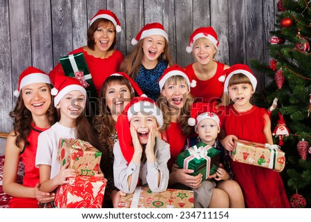 Large Group of happy people in Christmas hat with presents  - stock photo