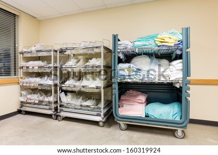 Large group of hospital supplies arranged in trolleys - stock photo