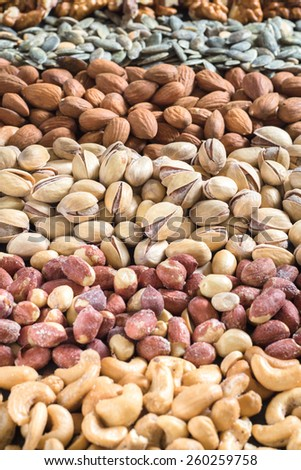Large group of nuts fruit,selective focus on the pistachios - stock photo