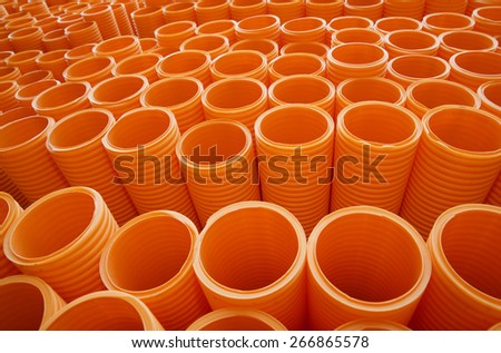 Large Group of Orange Industrial Plastic Pipes Full Frame - stock photo