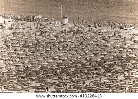 Large group of parasols at the beach of Rimini, Itali. Old style, sepia