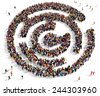 Large group of people gathered together in the shape of a labyrinth - stock photo