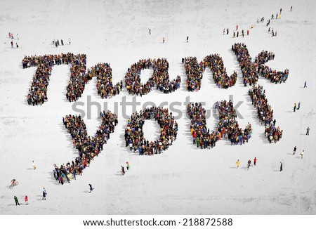 "Large group of people seen from above, gathered in the shape of ""Thank you!"" text, on concrete background - stock photo"