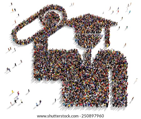 Large group of people seen from above gathered together in the shape of a graduate icon - stock photo