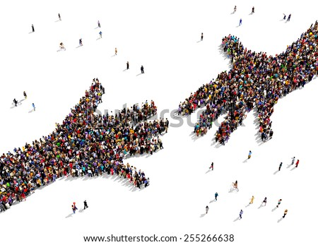 Large group of people seen from above gathered together in the shape of two hands reaching out each other - stock photo