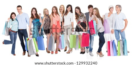 Large group of people with shopping bags. Isolated on white - stock photo
