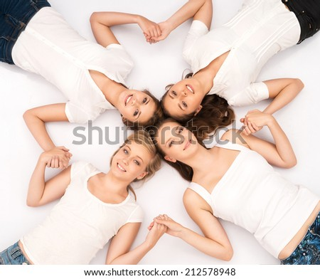 Large group of smiling teenage friends looking at camera isolated on white - stock photo