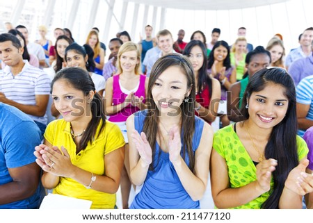 Large group of Students applausing  - stock photo