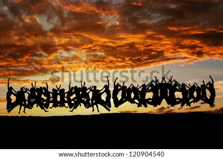 large group of teens jumping in sunset - stock photo