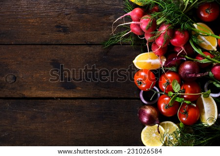 Large group of vegetables and fruit on the wooden background with blank space - stock photo