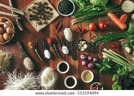 Large group of vegetables and ingredients on table