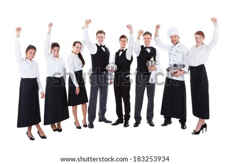 Large group of waiters and waitresses cheering. Isolated on white
