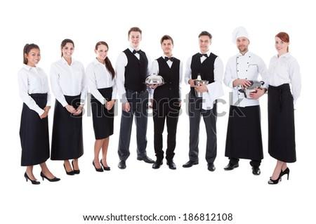 Large group of waiters and waitresses. Isolated on white - stock photo