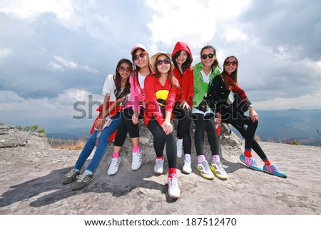 Large group of young people enjoying on the mountain  - stock photo