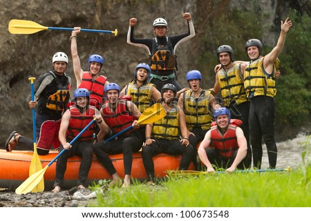 LARGE GROUP OF YOUNG PEOPLE READ TO GO RAFTING  - stock photo