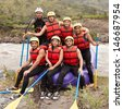 LARGE GROUP OF YOUNG PEOPLE READY TO GO RAFTING  - stock photo