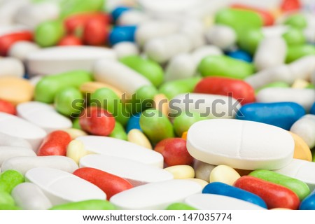 Large groups of many different pills and tablets of different colors