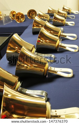 Large handbells set in a row and ready for performance - stock photo